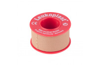 Leukoplast hechtpleister textiel met ring 5mx2.5cm huidskleur 1522